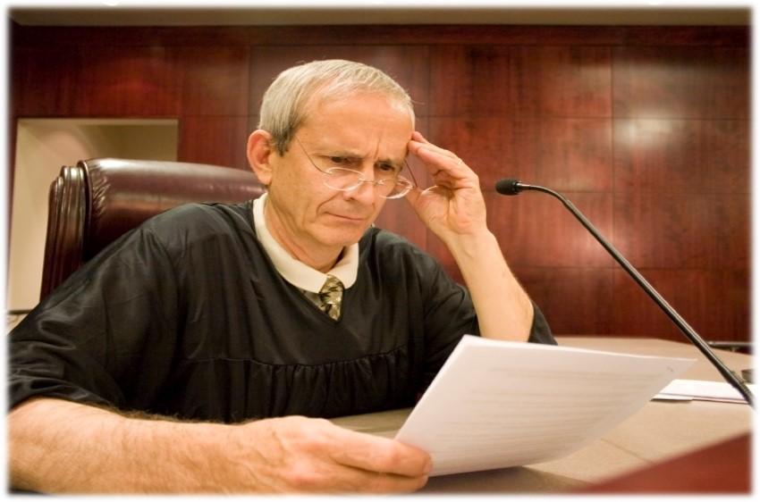 judge reading appellate brief